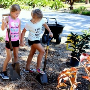 Sophia's bestie Rylin (L) assists with the digging of the hole.
