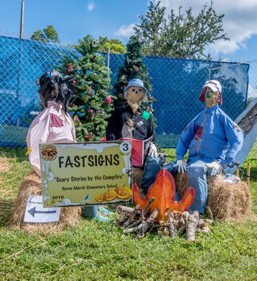 2018 Scarecrows in the Park competition - Scary Stories by the Camp Fire, built by Harns Marsh Elementary School and Sponsored by FastSigns