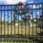 Festively adorned gate to the Community Garden at Lakes Park, Fort Myers FL