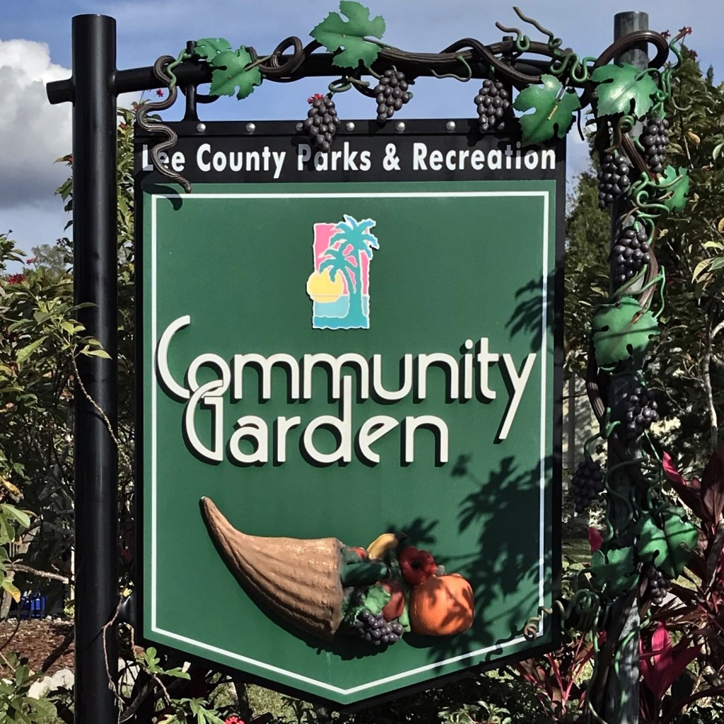 Community Garden sign at Lakes Park in Fort Myers features a grapevine and cornucopia