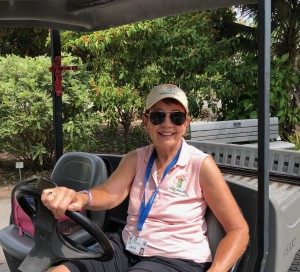 Random photo of Kathy Busick, who was recently trained to drive utility carts in the gardens