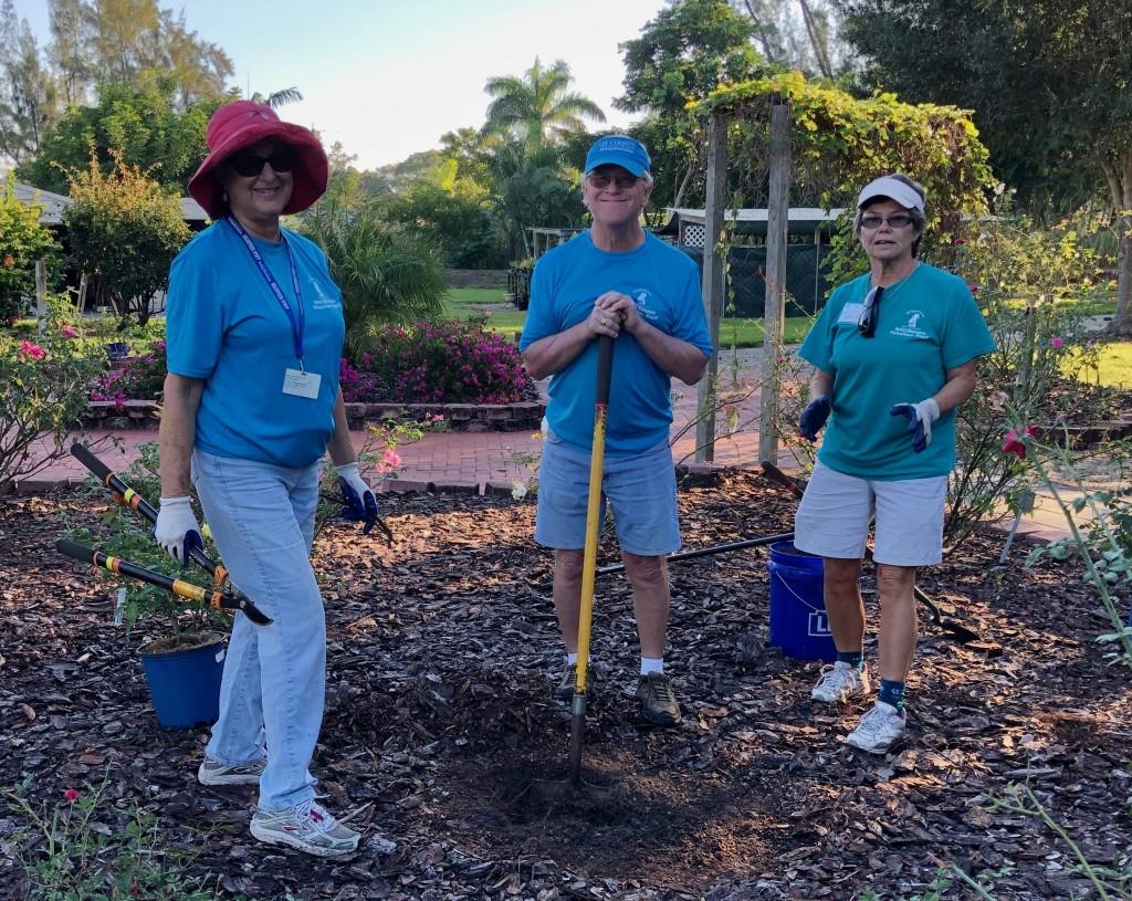 Ann, Roger, and Karen dig holes for the new rose bushes