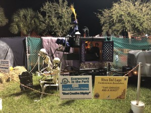 """Scarecrows in the Park - Most Creative Display: Riva Del Lago Condominium Association, """"Two Ghoules and a Hurst"""""""
