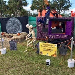 """Scarecrows in the Park Best Overall Display: Riva Del Lago Condominium Association, """"Two Ghouls and a Hurst"""""""