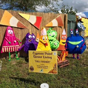 """Scarecrows in the Park Best Youth Group Created Display: St. Francis Xavier Catholic School, """"Fall Friends"""", sponsored by Cypress Point Senior Living"""