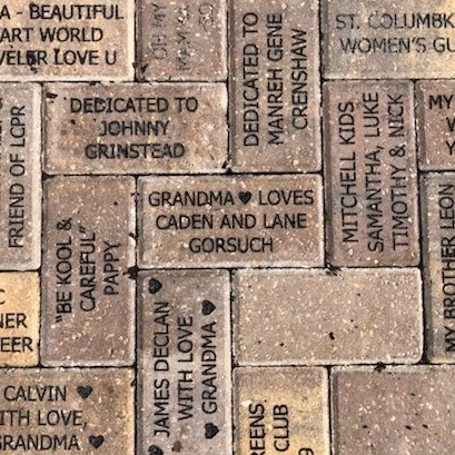 Brick dedications in the Childrens Garden at Lakes Park, July 2020