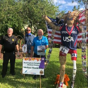 VIP JUDGES pose with Scarecrows in the Park Entry by Buckingham Exceptional Student School depicts 2-time American Paralympian and bronze medalist Melissa Stockwell. Who's Your American Hero?